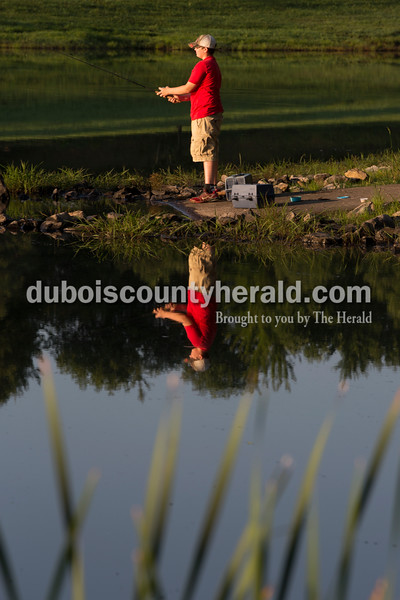 Sarah Ann Jump/The Herald Landon Gutgsell of Celestine, 12, fished during the 4-H fishing contest at the Dubois County Park South Lake in Bretzville on Thursday.