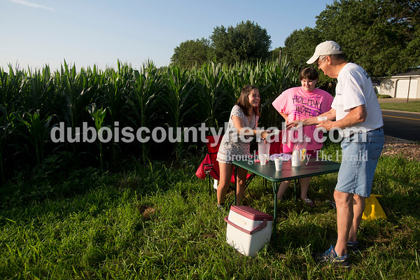 Sarah Ann Jump/The Herald Sophie Paeth, left, Peyton Gilles, both 13 and of Jasper, sold lemonade to Larry Hochmeister of Jasper at their stand near Peyton's neighborhood in Jasper on Monday. The girls set up the lemonade stand around 2pm and worked it for several hours until they had sold five pitchers worth at a quarter per cup. Sophie and Peyton have been best friends since kindergarten.