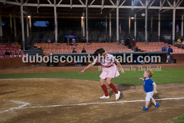 Sarah Ann Jump/The Herald Rockford Peach Shelby Klem of Birdseye ran the bases with Hutton Schmidt of Jasper, 2, after Wednesday evening's Dubois County Bombers game against the Muhlenberg County Stallions at League Stadium in Huntingburg. The Bombers won 5-1.