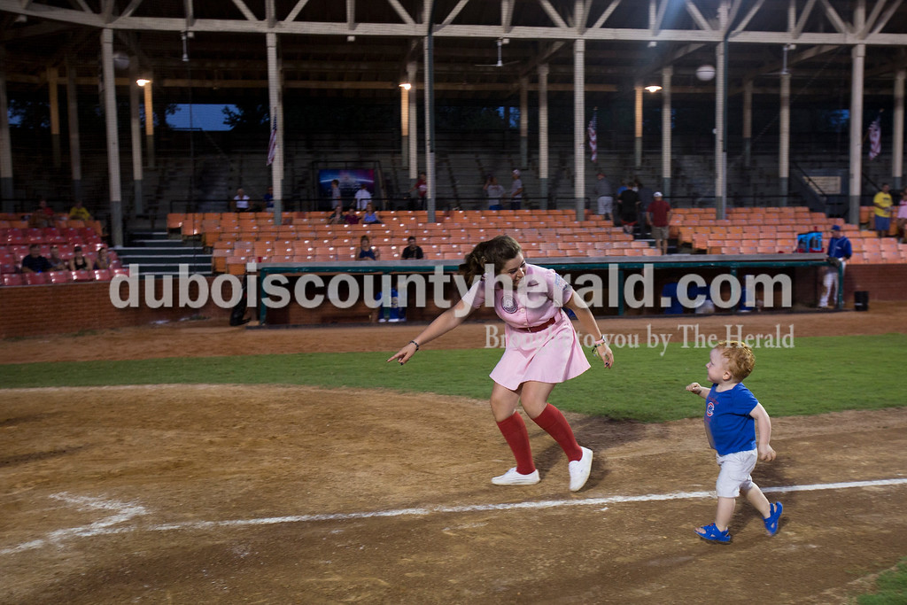 Sarah Ann Jump/The Herald<br /> Rockford Peach Shelby Klem of Birdseye ran the bases with Hutton Schmidt of Jasper, 2, after Wednesday evening's Dubois County Bombers game against the Muhlenberg County Stallions at League Stadium in Huntingburg. The Bombers won 5-1.