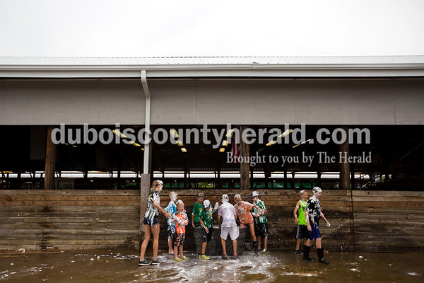 Kids splashed in one of the water troughs outside the beef barn during the annual shaving cream fight on Thursday morning at the Dubois County 4-H Fairgrounds in Bretzville.   Alisha Jucevic/The Herald