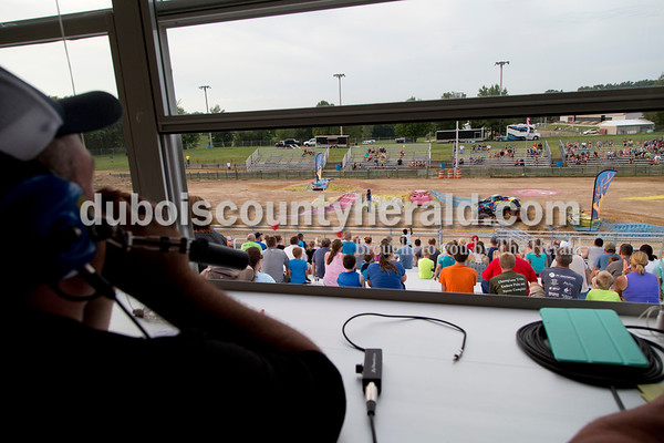 Sarah Shaw/The Herald  Announcer Blake Hutchcraft of Eureka, Mo., urged the crowd to cheer while the Puzzle Master performed during the Mini Monster Truck show at the Dubois County 4-H Fairgrounds in Bretzville on Tuesday. Lil Monster Trucks, a professional mini monster truck team out of St. Louis, visited the Dubois County 4-H Fair for the first time this year. Seven drivers, ages 6 to 15 raced and performed freestyle tricks.