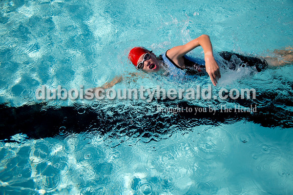 Sarah Shaw/The Herald  Abe Eckman of Jasper, 12, swam across the pool during the 4th annual Dubois County Youth Triathlon and Duathlon on Saturday at Huntingburg City park.