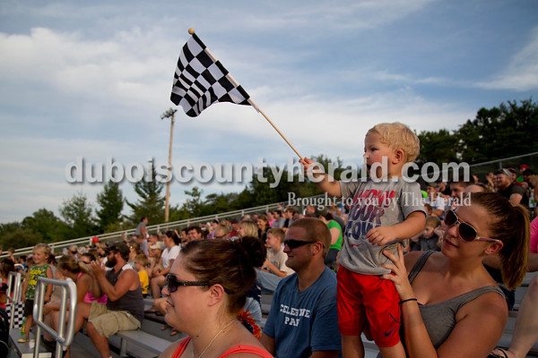 Sarah Shaw/The Herald  Griffin Hembree of St. Anthony, 3, cheered with his mom Samantha Phillips during the Mini Monster Truck show at the Dubois County 4-H Fairgrounds in Bretzville on Tuesday. Lil Monster Trucks, a professional mini monster truck team out of St. Louis, visited the Dubois County 4-H Fair for the first time this year. Seven drivers, ages 6 to 15 raced and performed freestyle tricks.