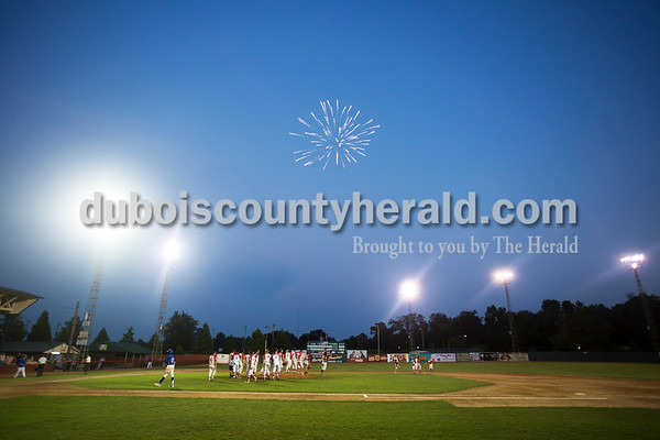 Sarah Ann Jump/The Herald A firework shot from the scoreboard by Steve Blessinger of Huntingburg burst over the field after Wednesday evening's Dubois County Bombers game against the Muhlenberg County Stallions at League Stadium in Huntingburg. The Bombers won 5-1.