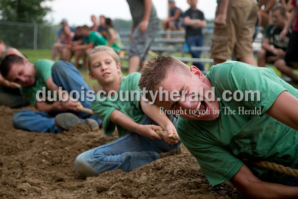 Sarah Shaw/The Herald  Garrett Betz of Schnellville, 15, let out a loud grunt as he pulled the rope during the tug-of-war competition at the Dubois County 4-H Fairgrounds in Bretzville on Thursday evening.