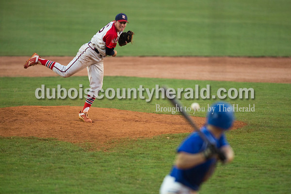 Sarah Ann Jump/The Herald Bombers' Austin Krizan delivered a pitch during Wednesday evening's Dubois County Bombers game against the Muhlenberg County Stallions at League Stadium in Huntingburg. The Bombers won 5-1.