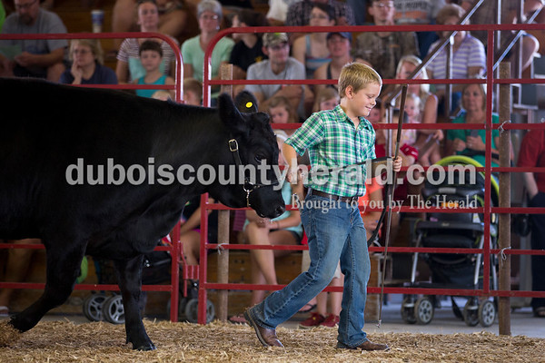 Sarah Ann Jump/The Herald Braxton Mitchell of Schnellville, 10, showed his heifer in the beef show at the Dubois County 4-H Fairgrounds in Bretzville on Thursday.