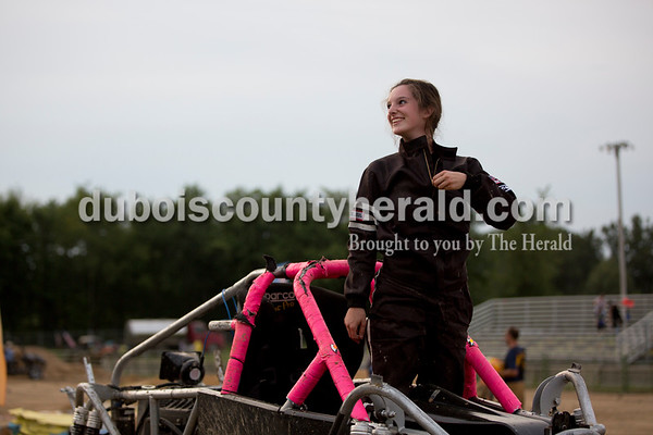 """Sarah Shaw/The Herald  """"Lil Miss Mini Patrol"""" driver Diana Prawl of Arnold, Mo., 15, listened to cheers from the crowd after continuing to perform after flipping her truck during the Mini Monster Truck show at the Dubois County 4-H Fairgrounds in Bretzville on Tuesday. Lil Monster Trucks, a professional mini monster truck team out of St. Louis, visited the Dubois County 4-H Fair for the first time this year. Seven drivers, ages 6 to 15 raced and performed freestyle tricks."""