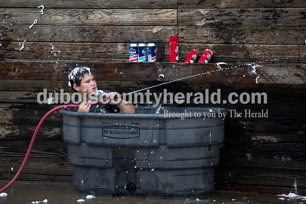 Will Werner of Ferdinand, 11, sprayed water on his friends during the annual shaving cream fight on Thursday morning at the Dubois County 4-H Fairgrounds in Bretzville.   Alisha Jucevic/The Herald