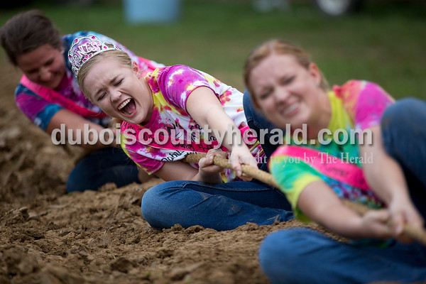 Sarah Shaw/The Herald  Miss Photogenic Elizabeth Huebner of Jasper, 19, Miss Dubois County 4-H Fair Queen Jessica Hilsmeyer of St. Henry, 18, and 1st Runner-Up Kelly Vonderheide pulled the rope during the tug-of-war competition at the Dubois County 4-H Fairgrounds in Bretzville on Thursday evening. The queen contestants made pink duct tape sashes to wear for the competition.