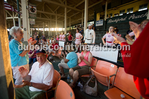 """Sarah Ann Jump/The Herald Fans clapped along to the song """"Cotton Eye Joe"""" as the Rockford Peaches and mascot Casey performed the line dance during Wednesday evening's Dubois County Bombers game against the Muhlenberg County Stallions at League Stadium in Huntingburg. The Bombers won 5-1."""