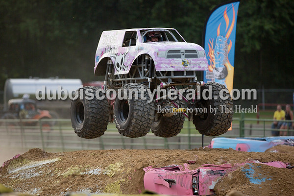 """Sarah Shaw/The Herald  """"Dixie Chic"""" driver Kelby Schoenfeld of Rosebud, Mo., 11, caught some air during the Mini Monster Truck show at the Dubois County 4-H Fairgrounds in Bretzville on Tuesday. Lil Monster Trucks, a professional mini monster truck team out of St. Louis, visited the Dubois County 4-H Fair for the first time this year. Seven drivers, ages 6 to 15 raced and performed freestyle tricks."""