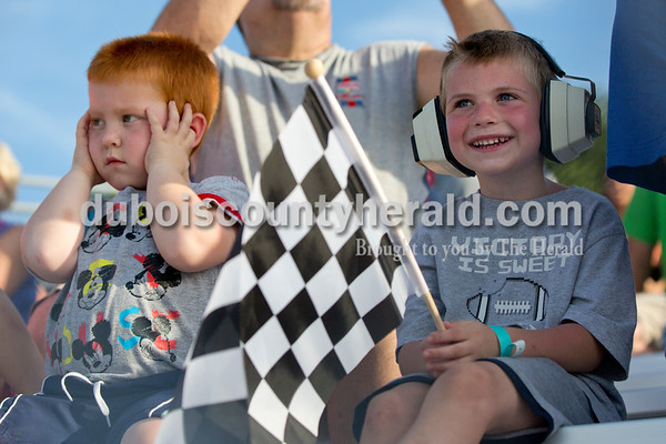 Sarah Shaw/The Herald  Jayden Stout of Ferdinand, 4, and Joshua Jacobs of Perry County, 4, watched the Mini Monster Truck show at the Dubois County 4-H Fairgrounds in Bretzville on Tuesday. Lil Monster Trucks, a professional mini monster truck team out of St. Louis, visited the Dubois County 4-H Fair for the first time this year. Seven drivers, ages 6 to 15 raced and performed freestyle tricks.