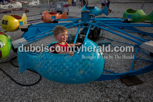 Cohen Begle of Jasper, 1, enjoyed the carnival rides on Tuesday evening at the Dubois County 4-H Fair in Bretzville.   Alisha Jucevic/The Herald