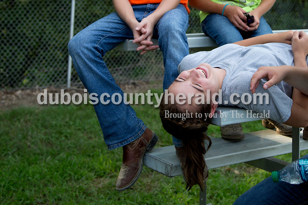 Sarah Shaw/The Herald  Olivia Durcholz of Huntingburg, 13, joked with friends before the tug-of-war competition at the Dubois County 4-H Fairgrounds in Bretzville on Thursday evening.