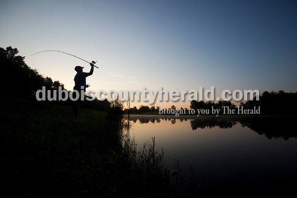 Sarah Ann Jump/The Herald Seth Hartwick of Jasper, 13, cast his line during the 4-H fishing contest, which began at sunrise, at the Dubois County Park South Lake in Bretzville on Thursday. Seth said he gets up early two to three times a week to fish at sunrise.