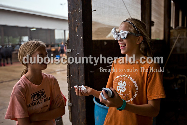 Katlyn Betz of Schnellville, 10, laughed at her cousin, Lydia Betz of Schnellville, 11, after Lydia sprayed shaving cream on her own face before the annual shaving cream fight began on Thursday morning at the Dubois County 4-H Fairgrounds in Bretzville.   Alisha Jucevic/The Herald