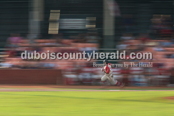 Sarah Ann Jump/The Herald Bombers' DeShawn Johnson ran to first during Wednesday evening's Dubois County Bombers game against the Muhlenberg County Stallions at League Stadium in Huntingburg. The Bombers won 5-1.