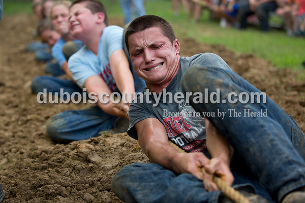 Sarah Shaw/The Herald  Prestyn Balsmeyer of Huntingburg, 17, grimaced while pulling the rope during the tug-of-war competition at the Dubois County 4-H Fairgrounds in Bretzville on Thursday evening.