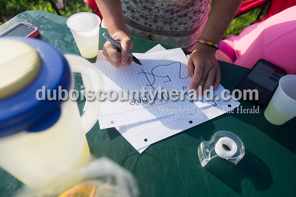 Sarah Ann Jump/The Herald Sophie Paeth of Jasper, 13, made a sign for the lemonade stand in Jasper on Monday.