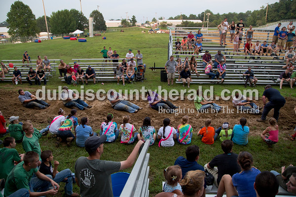 Sarah Shaw/The Herald  Adults competed in the tug-of-war competition at the Dubois County 4-H Fairgrounds in Bretzville on Thursday evening. This is the first year for the adult competition.