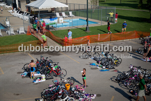 Sarah Shaw/The Herald  Participants rested in the transition area before the start of the 11-12 age group during the Dubois County Youth Triathlon and Duathlon on Saturday at Huntingburg City Park.