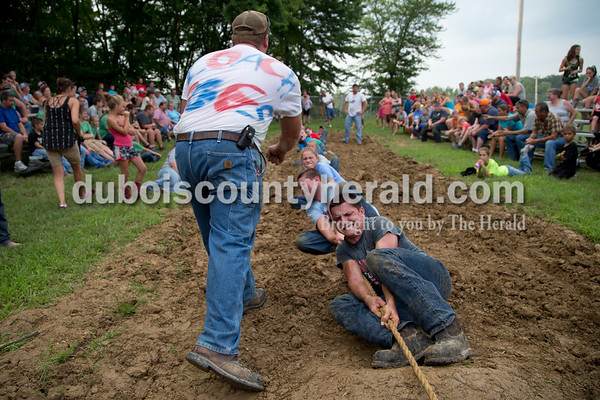 Sarah Shaw/The Herald  Adam Wagner of St. Henry coached Prestyn Balsmeyer of Huntingburg, 17, and the rest of the team during the tug-of-war competition at the Dubois County 4-H Fairgrounds in Bretzville on Thursday evening.