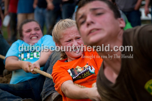Sarah Shaw/The Herald  Marie Tempel of St. Henry, 11, center, pulled the rope during the tug-of-war competition at the Dubois County 4-H Fairgrounds in Bretzville on Thursday evening.