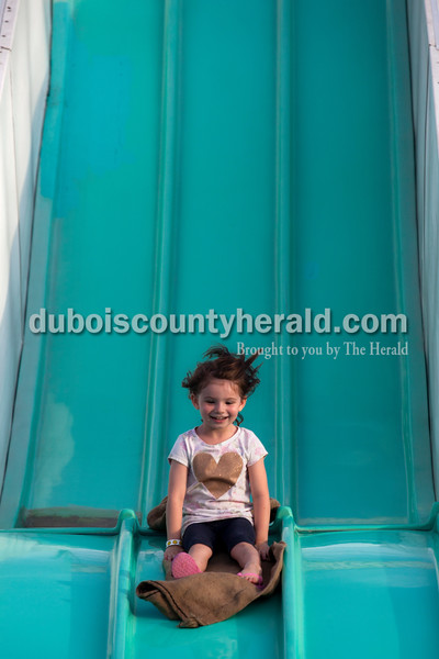 """Emmerson Schwinghammer of Huntingburg, 4, slid down the Wild Thing slide on Tuesday evening at the Dubois County 4-H Fair in Bretzville. """"She's not scared of anything,"""" her father Chris said.     Alisha Jucevic/The Herald"""