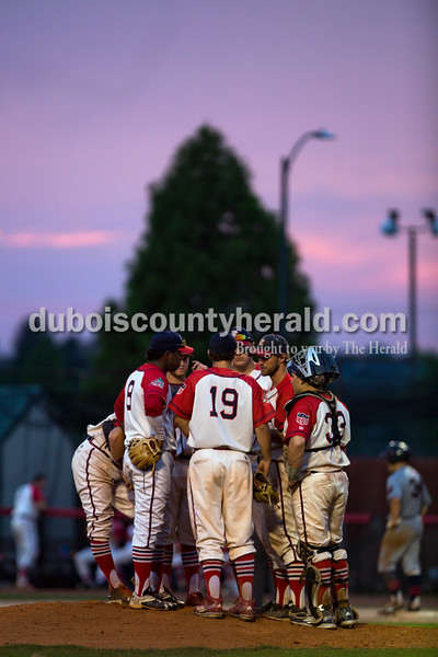 The Bombers huddled on the pitchers mound with coach Andy Lasher during their first matchup in the Ohio Valley League playoffs on Monday night at League Stadium in Huntingburg. The Bombers defeated the Paducah Chiefs 7-5. Alisha Jucevic/The Herald
