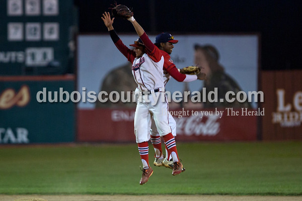 Bombers' Macy Holdsworth and Michael Rodriguez jumped into the air in celebration after winning their first matchup in the Ohio Valley League playoffs on Monday night at League Stadium in Huntingburg. The Bombers defeated the Paducah Chiefs 7-5. Alisha Jucevic/The Herald
