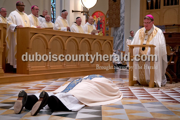 Sarah Shaw/The Herald  Archabbot Kurt Stasiak lay prostrate on the floor before Archbishop of Indianapolis Joseph W. Tobin during the blessing of the new archabbot at St. Meinrad Archabbey in St. Meinrad on Tuesday.  Stasiak, born in Germany and raised in Virginia, is the 10th abbot of St. Meinrad Archabbey, succeeding Archabbot Justin DuVall.