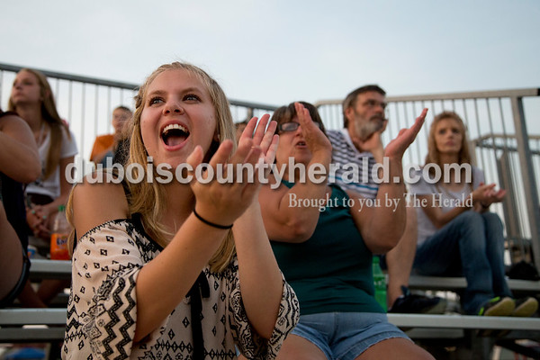 Sarah Shaw/The Herald  Shea Singer of Bretzville, 15, cheered during the demolition derby at the Dubois County 4-H Fairgrounds in Bretzville on Saturday.