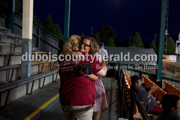 """Rockford Peach Joyce Lawrence of Huntingburg embraced Sarah Jochem of St. Henry, 18, as the Bombers' first matchup in the Ohio Valley League playoffs came to a close on Monday night at League Stadium in Huntingburg. Lawrence said goodbye to her five-summer job as a peach on Monday night. """"It's nostalgic because I've watched it grow so much,"""" she said. Lawrence was part of the first group of Peaches to work at League Stadium but with college graduation on the horizon, she'll be busy next summer with a full-time job. """"I'll definitely be back here as a fan,"""" she said.    Alisha Jucevic/The Herald"""