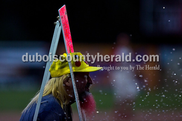 Keith Lahee of Santa Claus winced as water from a water balloon pelted toward him during the Bombers' first matchup in the Ohio Valley League playoffs on Monday night at League Stadium in Huntingburg. The Bombers defeated the Paducah Chiefs 7-5. Alisha Jucevic/The Herald
