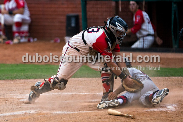 Bombers' catcher Trey Fulton reached out for a late tag as Chiefs' Daniel Seitzinger slid into home during the Bombers' first matchup in the Ohio Valley League playoffs on Monday night at League Stadium in Huntingburg. The Bombers defeated the Paducah Chiefs 7-5. Alisha Jucevic/The Herald