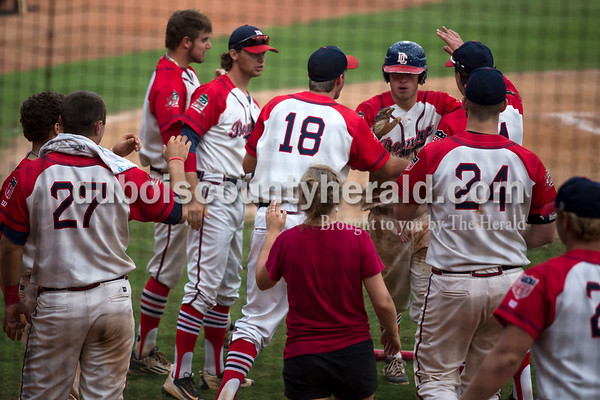 The Bombers congratulated teammate Connor Echols after he made the second run of the night during the Bombers' first matchup in the Ohio Valley League playoffs on Monday night at League Stadium in Huntingburg. The Bombers defeated the Paducah Chiefs 7-5. Alisha Jucevic/The Herald