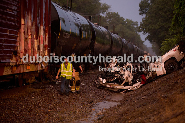 Sarah Shaw/The Herald  The Dubois County Sheriff Department, Huntingburg Fire Department, and Dubois County Coroner's office responded to a fatal car accident on the railroad tracks crossing South 600 West in Duff on Thursday.