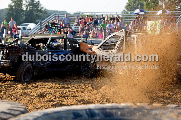 Sarah Shaw/The Herald  Andy Rickenbaugh of Celestine slammed into Billy Raetz of Bristow during the full-modified class of the demolition derby at the Dubois County 4-H Fairgrounds in Bretzville on Saturday. Rickenbaugh placed first, while Raetz placed second.