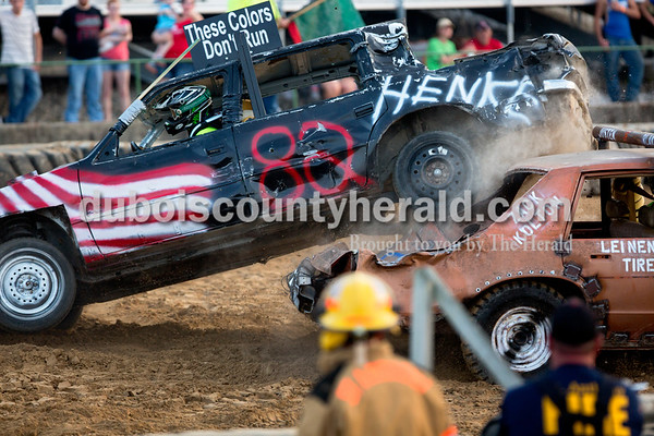 Sarah Shaw/The Herald  Deion Henke of Ferdinand reversed his car on top of Justen Ferguson of Huntingburg during the full-stock class of the demolition derby at the Dubois County 4-H Fairgrounds in Bretzville on Saturday. Henke won the Mad Dog award for the full-stock class.