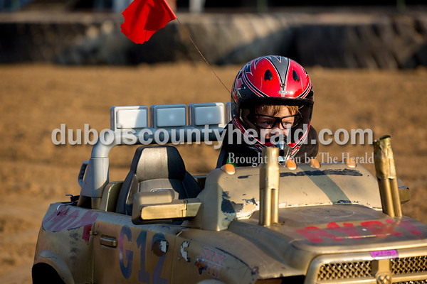 Sarah Shaw/The Herald  Ryland Gerber of Winslow, 4, drove his power wheels around the track during the demolition derby at the Dubois County 4-H Fairgrounds in Bretzville on Saturday.