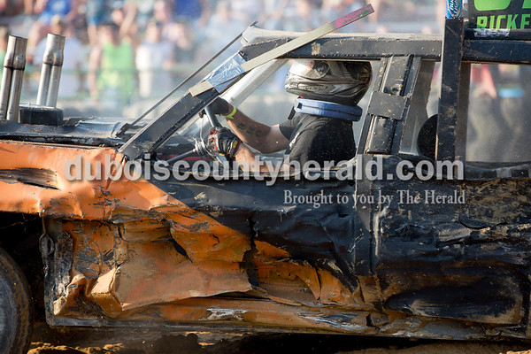 Sarah Shaw/The Herald  Andy Rickenbaugh of Celestine sped around the track during the full-modified class of demolition derby at the Dubois County 4-H Fairgrounds in Bretzville on Saturday. Rickenbaugh placed first place and won the Mad Dog award.