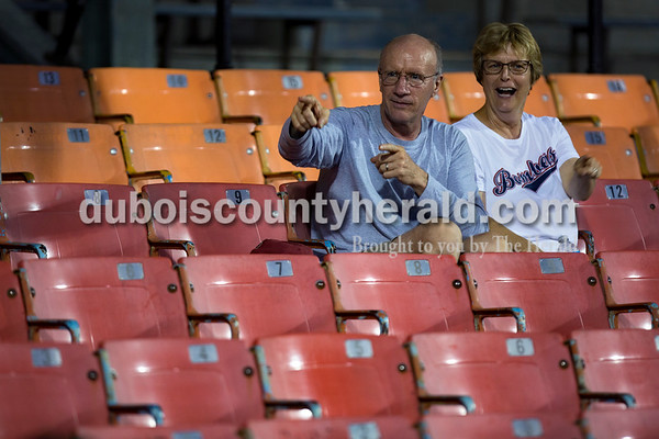 """Gary Schueler and his wife Karen, both of St. Anthony, danced along to """"YMCA"""" during the Bombers' first matchup in the Ohio Valley League playoffs on Monday night at League Stadium in Huntingburg. The Bombers defeated the Paducah Chiefs 7-5. Alisha Jucevic/The Herald"""