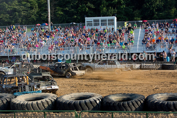 Sarah Shaw/The Herald  A crowd filled the grandstands to watch the demolition derby at the Dubois County 4-H Fairgrounds in Bretzville on Saturday.