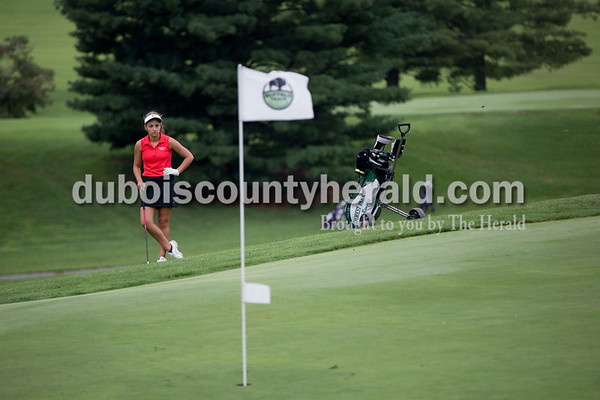 Forest Park's Emily Nord watched as her competitors putted during the Wildcat Invitational at Buffalo Trace Golf Course in Jasper on Saturday.  Sarah Shaw/The Herald