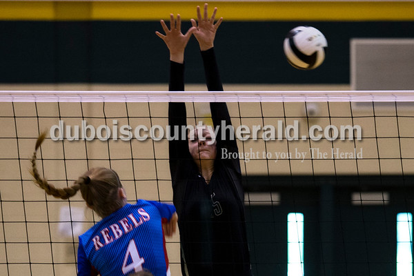 Forest Park's Courtney Borman attempted a block as South Spencer's Alyssa Crawford spiked the ball over the net during Monday night's game against South Spencer at Forest Park High School in Ferdinand. The Rangers fell 25-19, 19-25, 25-5, 25-19 to the Rebels.  Alisha Jucevic/The Herald