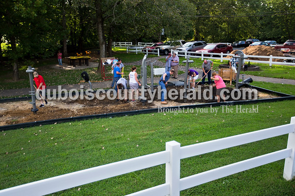 Boy Scout Troop 182, The Lions Club and Jasper Rotary Club members worked on a new adult handicap accessible fitness center just below Azura Cafe near the Riverwalk on Wednesday evening. The fitness center is now open to the public.  Alisha Jucevic/The Herald