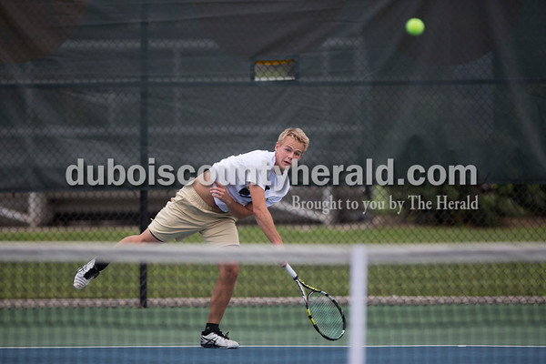Sarah Shaw/The Herald Jasper's Andrew Schmitt played in a doubles match against Castle during the tennis invitational in Jasper on Saturday.