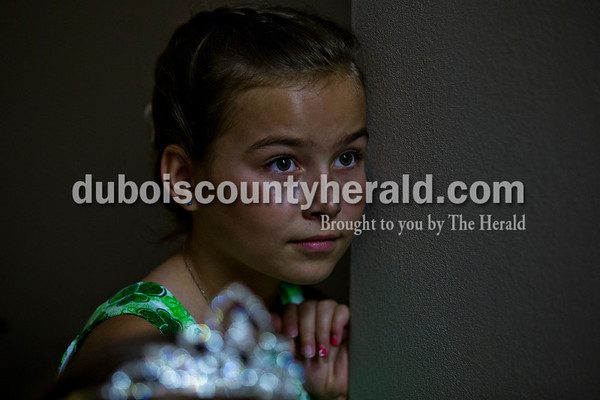 Ireland Elementary School lassie, Hannah Levy of Ireland, 11, watched the girls walk onstage for the Miss Ireland Bicentennial Queen pageant on Sunday at Ireland Elementary School.  Alisha Jucevic/The Herald